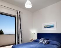 Camera-matrimoniale-Le-Capannelle-Appartamento-AIDA